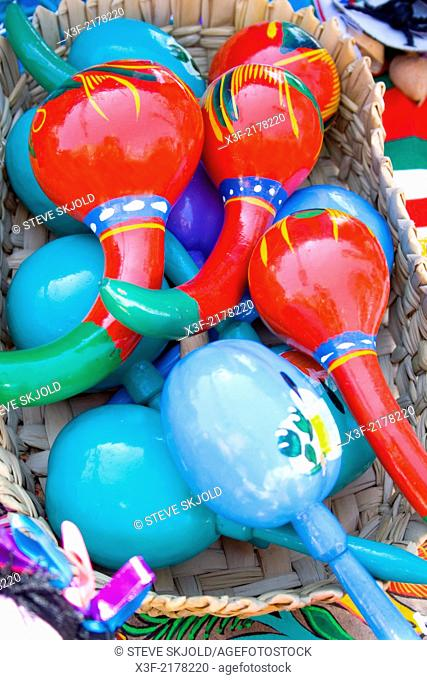 Basket of colorful Mexican maracas for sale at fiesta sidewalk shop. Mexican Independence Day Minneapolis Minnesota MN USA