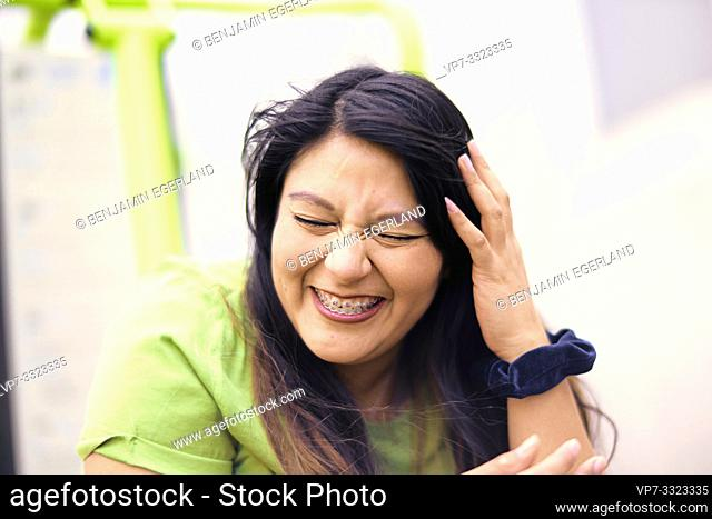 vibrant woman laughing