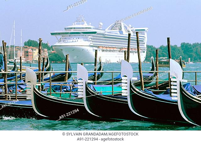 Cruise ship and gondolas. Venice. Italy