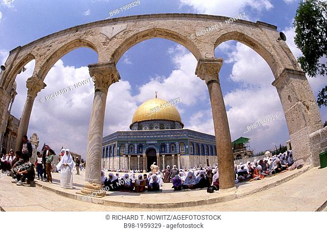 Women pray on the temple mount during Ramadan holiday
