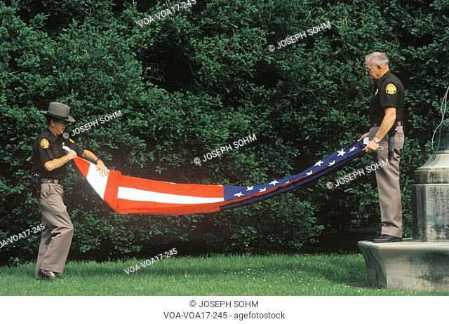 Two Officers Folding the American Flag, Charlottesville, Virginia