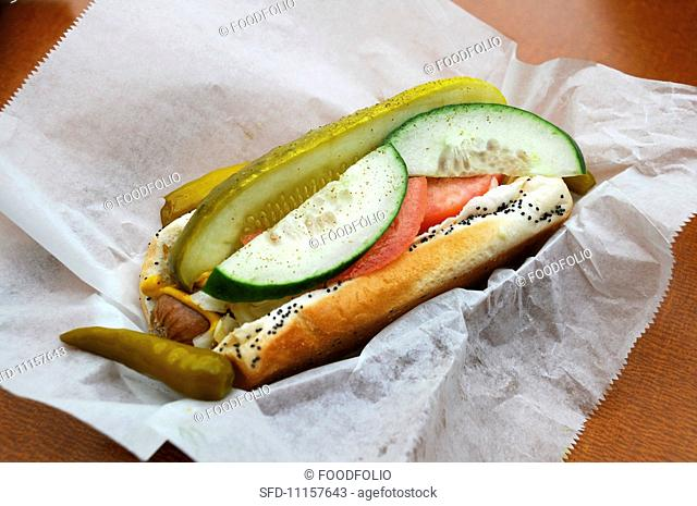 Chicago-style hot dog in paper