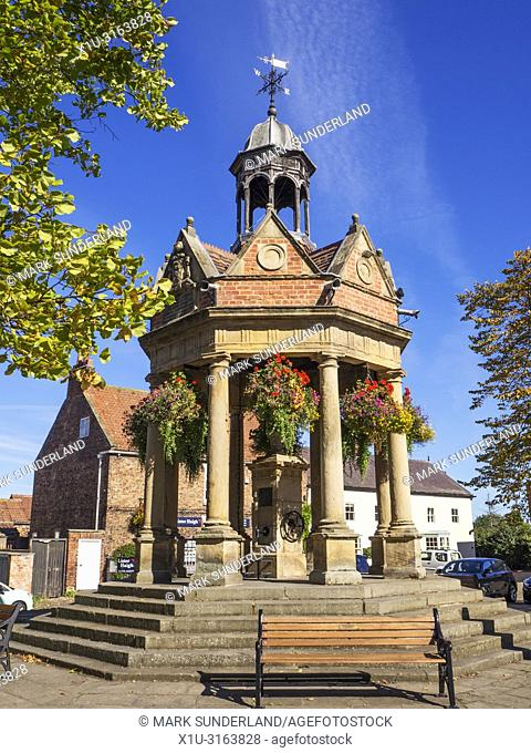 The Fountain former water pump in St James Square in early autumn at Boroughbridge North Yorkshire England