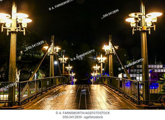 Turku, Finland An illuminated pedestrian and bicycle bridge over the Aura river
