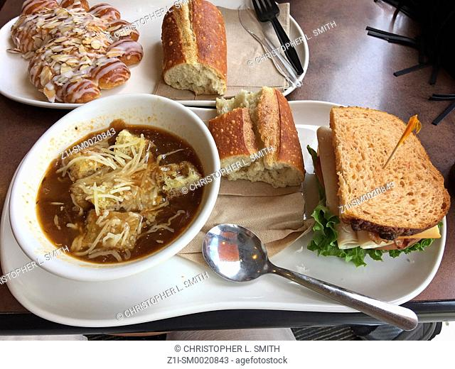 Lunchtime meal of Bistro French Onion Soup, Turkey Bravo sandwich, french bread and a bearclaw pastry