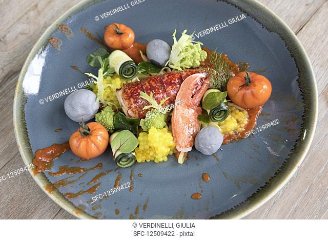 Plate of lobster salad with lobster meat and vegetables