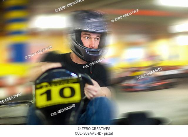 Young man racing in go cart