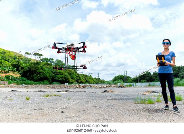 Young woman control Drone flying at outdoor