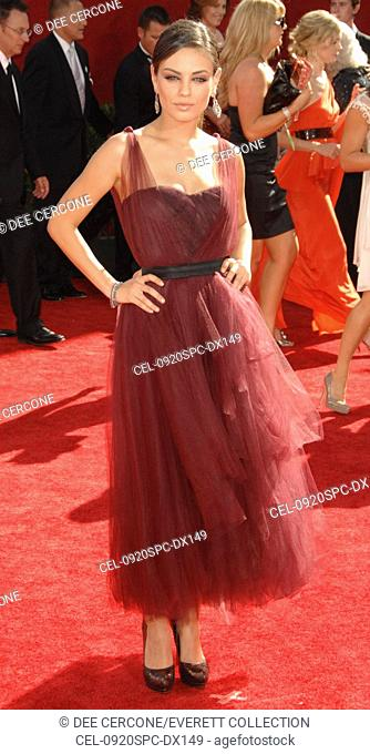 Mila Kunis (wearing a Monique Lhuillier dress) at arrivals for 61st Primetime Emmy Awards - ARRIVALS, Nokia Theatre, Los Angeles, CA September 20, 2009