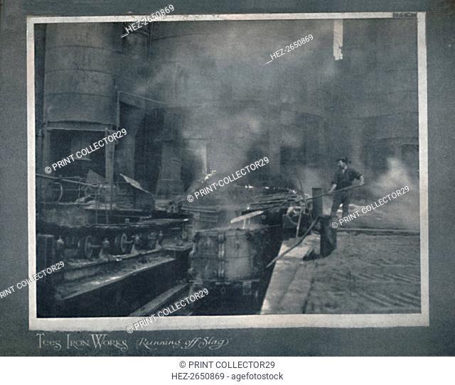 'Tees Iron Works - Running Off Slag', 1919. Artist: Hood & Co. Ltd