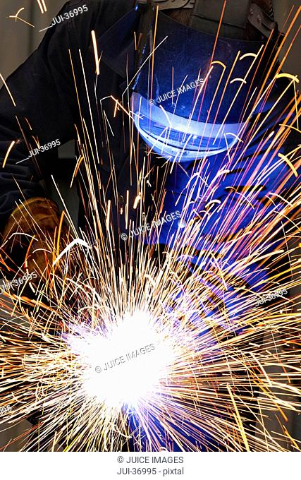 Close up of welder using welding saw