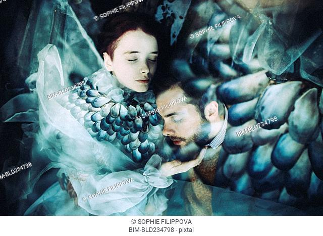 Caucasian woman and man cuddling