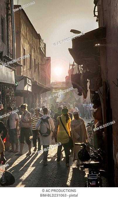 Crowd walking in street, Jamaa el Fna Square, Marrakesh, Morocco