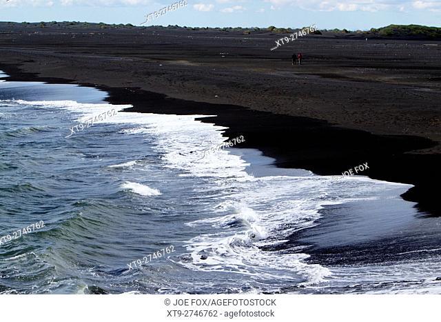 waves breaking on volcanic black sand beach bakki southern Iceland