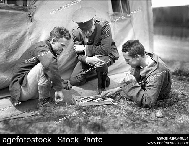 American Red Cross Man refereeing a Game of Checkers played by two Patients in the American Military Hospital No. 5, Auteuil, France, Lewis Wickes Hine