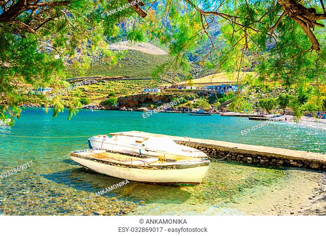 Small boat moored in cozy sea bay, Greece