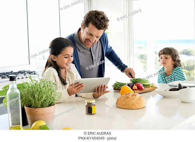 Man preparing food for his children