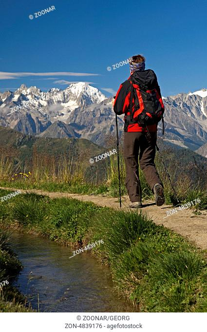 Hiker at the Verbier irrigation canal, Valais