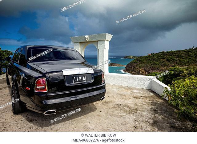 French West Indies, St-Barthelemy, Marigot, Rolls Royce car outside beach villa