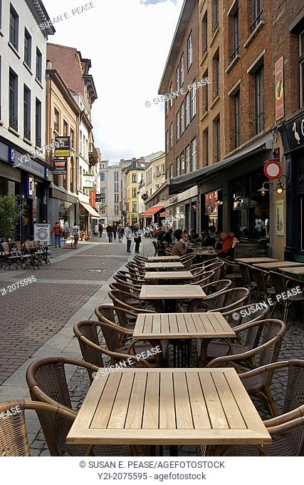 Europe, Belgium, Antwerp. Cafe tables along a street in Antwerp