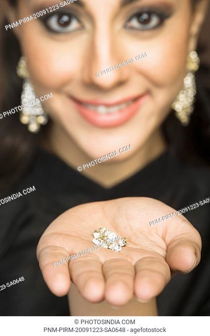 Portrait of a woman showing diamonds