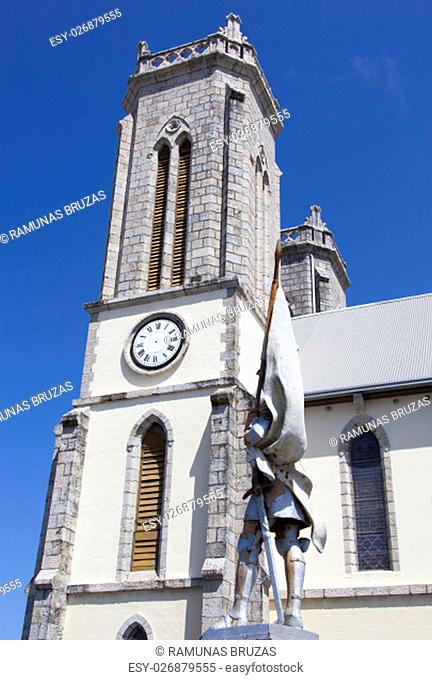 The tower of Saint Joseph's Cathedral with the statue of Joan of Arc next to (Noumea, New Caledonia)