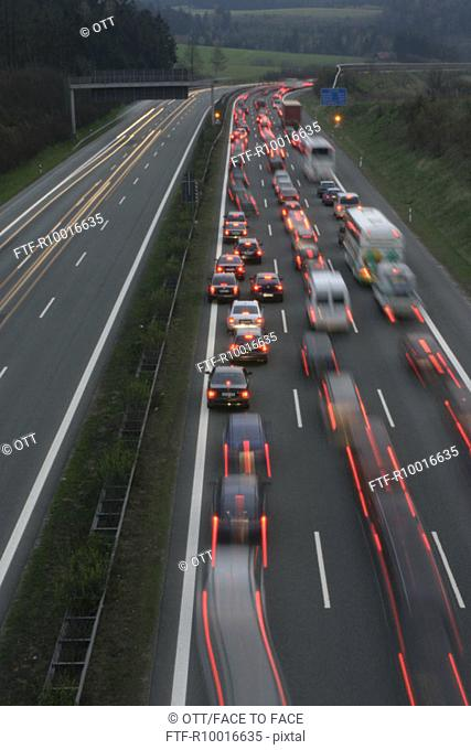 Large number of vehicles are seen zooming on the highway