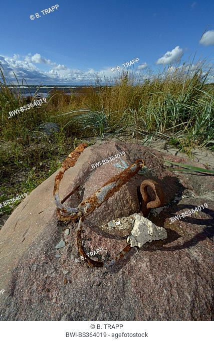 rusty anchor on a stone, Sweden, Gotland