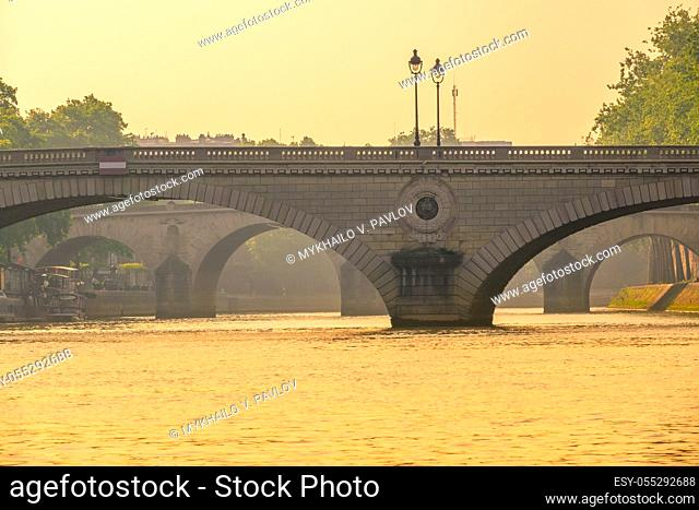 France. Stone bridges over the river Seine before sunset