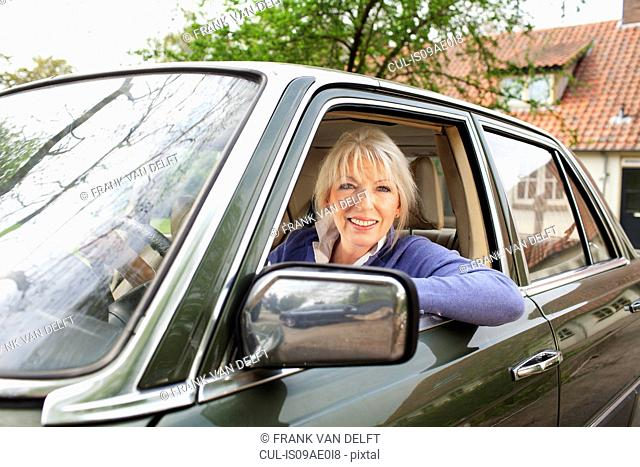 Portrait of mature woman in car