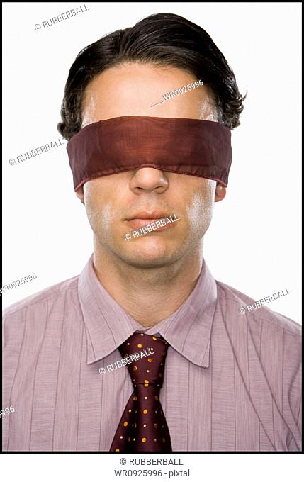 Close-up of a businessman wearing a blindfold