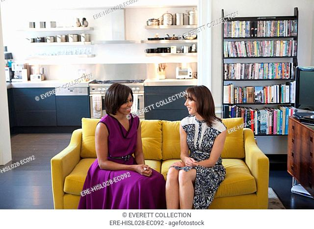 First Lady Michelle Obama and Samantha Cameron wife of British Prime Minister David Cameron talk before having tea in the private residence at Downing Street in...