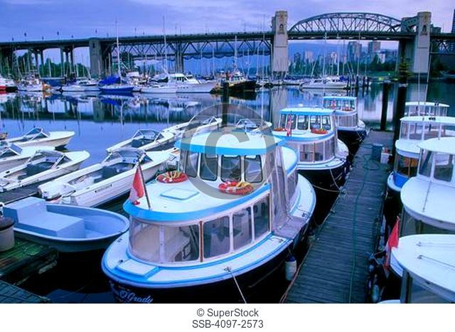 Ferry at a harbor with a bridge in the background, Burrard Street Bridge, False Creek, Granville Island, Vancouver, British Columbia, Canada
