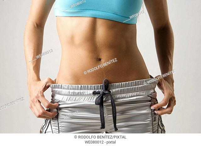 Young girl's flat stomach