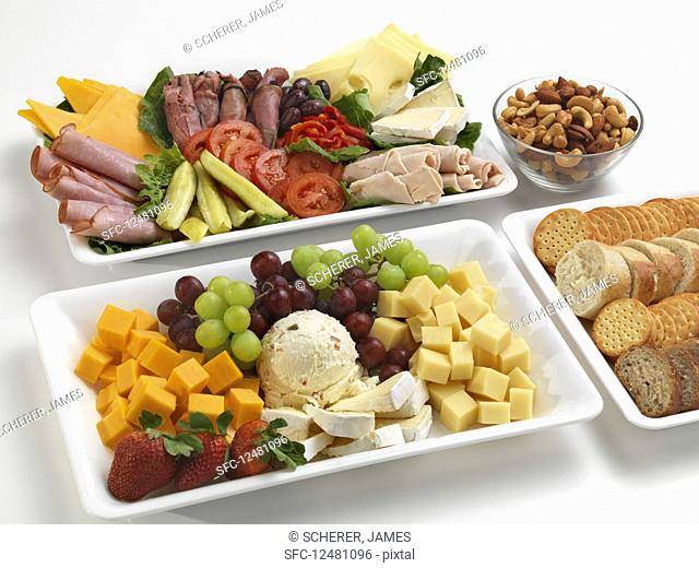 Various savory and sweet snacks on platters