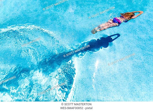 Spain, woman diving in swimming pool