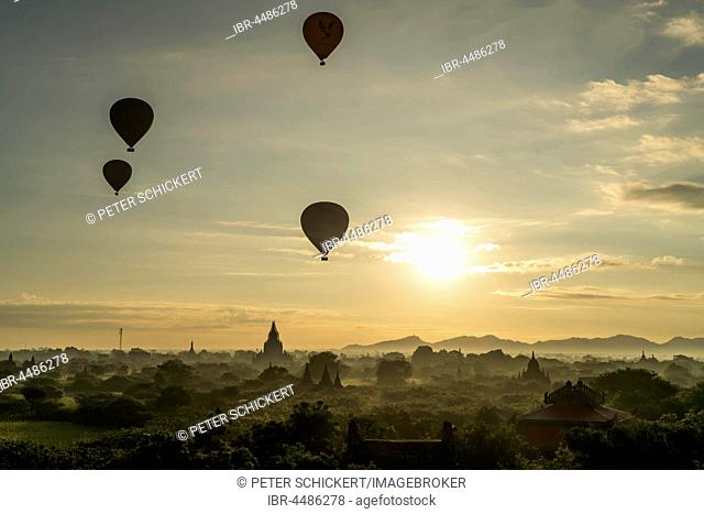 Hot air balloons at sunrise over temples and pagodas, Bagan, Mandalay, Myanmar