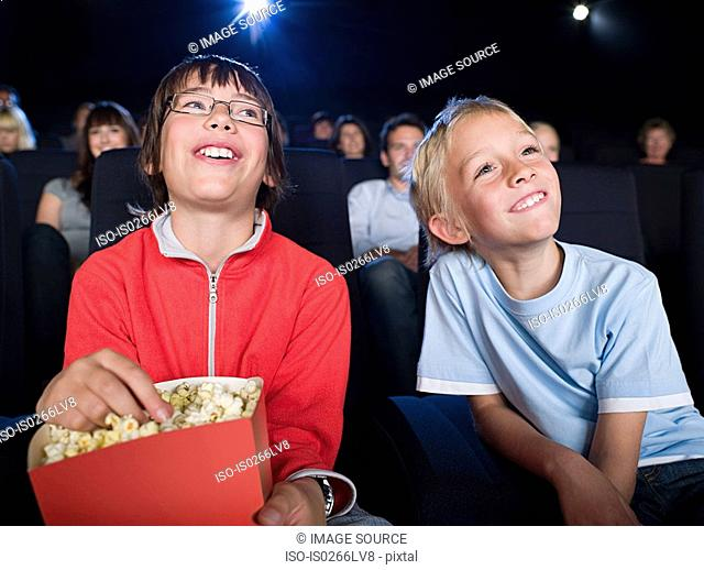 Two boys watching a movie