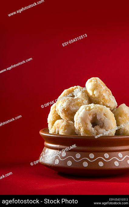 Indian Traditional Sweet Food Balushahi on a red background