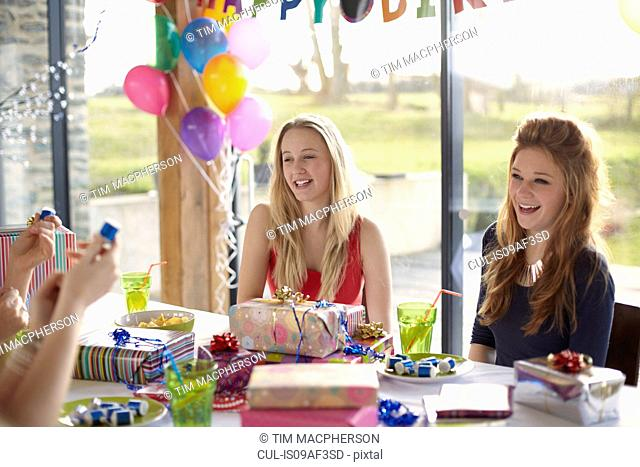 Teenage girl and friends enjoying birthday party