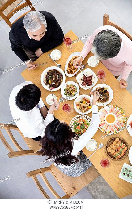 High angle view of harmonious family having meals
