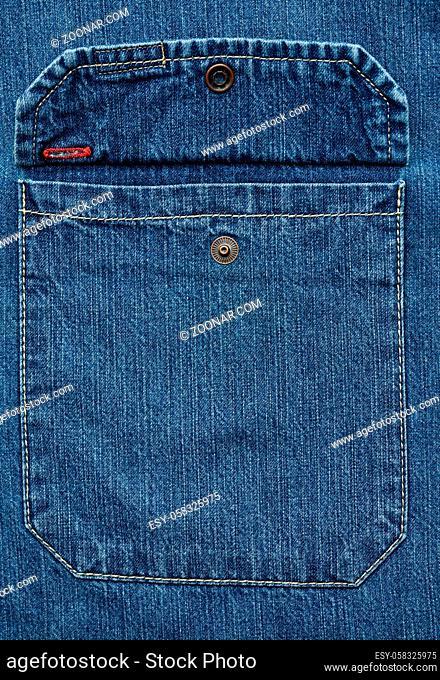 chest pocket with button denim blue shirt, full frame, close up