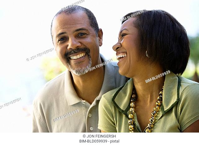African couple laughing