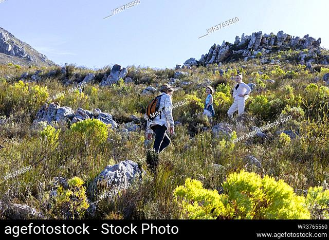 Family hiking a nature trail, Phillipskop nature reserve, Stanford, South Africa