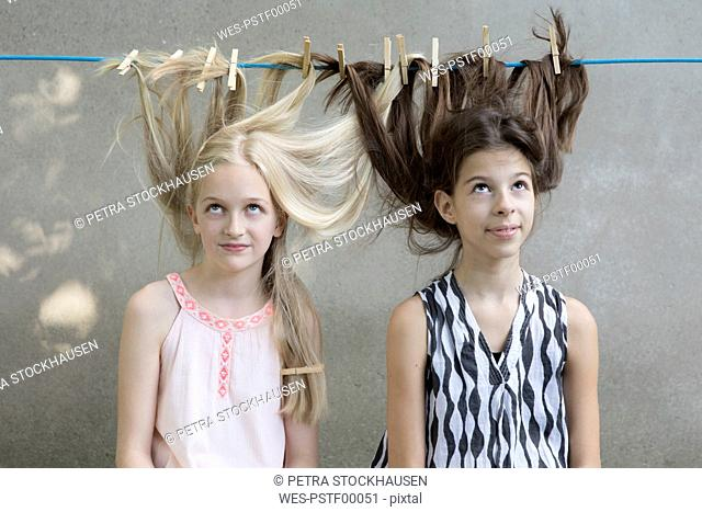 Girls hair drying on clothesline
