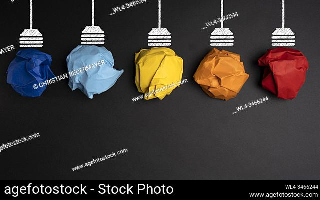 Develpoing a new idea with 5 coloured paper light bulbs. Before the idea