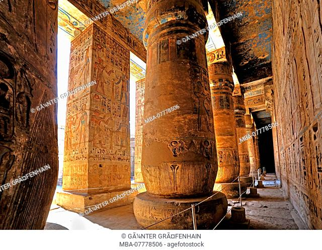 Column hall with reliefs and original colours in the second courtyard in the death temple of Ramses III Medinet Habu in Thebes-West, Luxor, Upper Egypt, Egypt