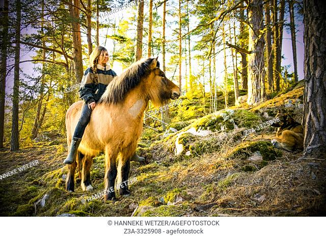 Girl on a horse in Swedish nature