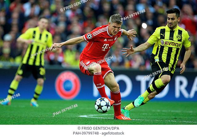 Munich's Bastian Schweinsteiger (L) and Dortmund's Ilkay Guendogan vie for the ball during the UEFA soccer Champions League final between Borussia Dortmund and...