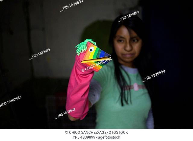 Mexican folk-art artist Jazmin Juarez holds a hand puppet in a Mexican folk-art workshop in Mexico City, Mexico